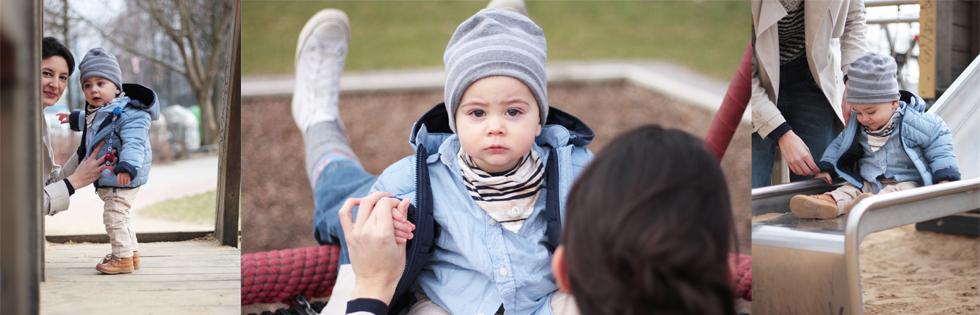 Kindermode von s.Oliver und Styling für Mama mit Culottes aus Jeans und Oberteil aus Spitze, Steppjacke fürs Baby und Trenchcoat für die Mama